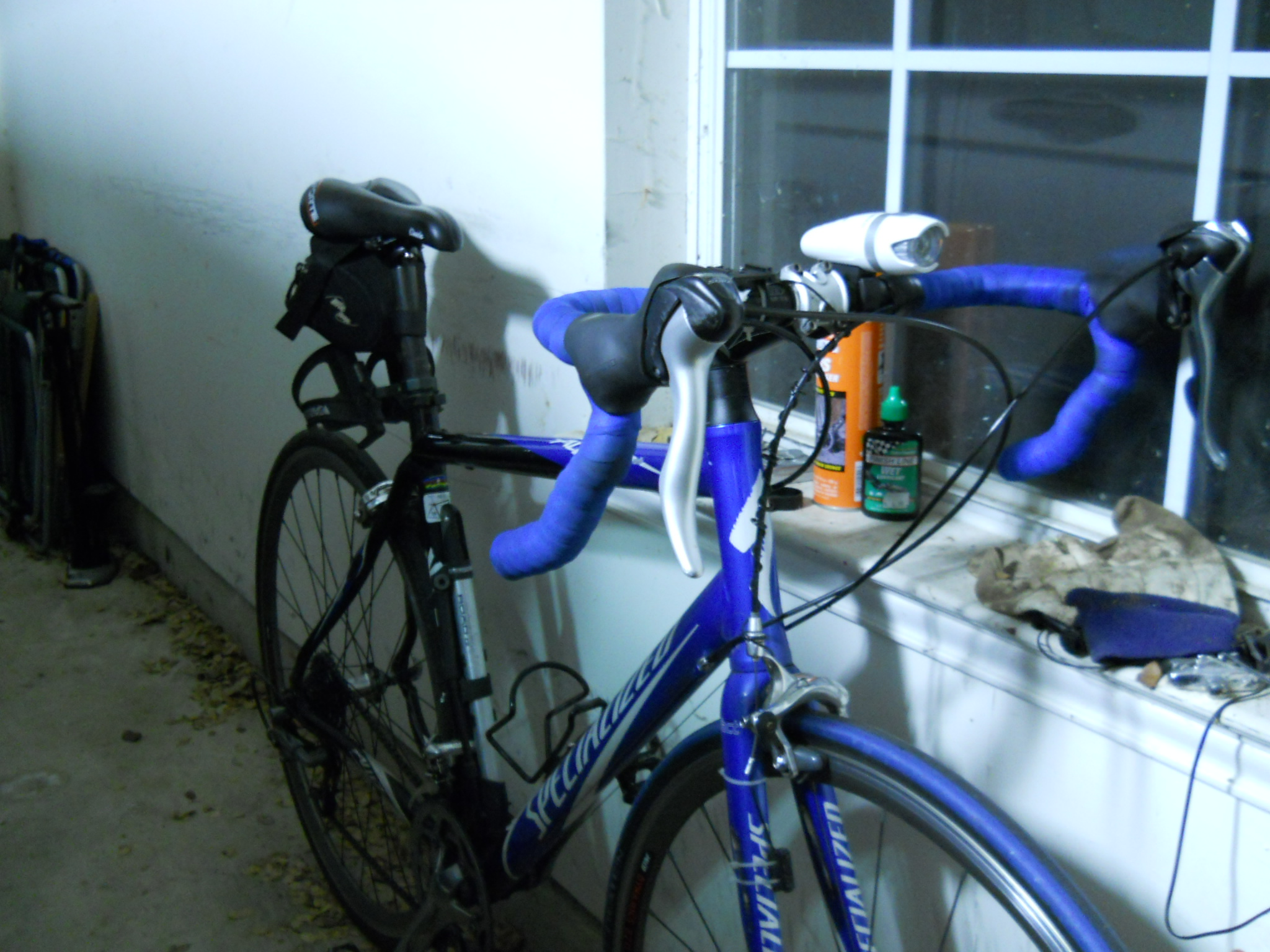 Even a quick snapshot in my cluttered garage shows the forward tilt to the saddle.