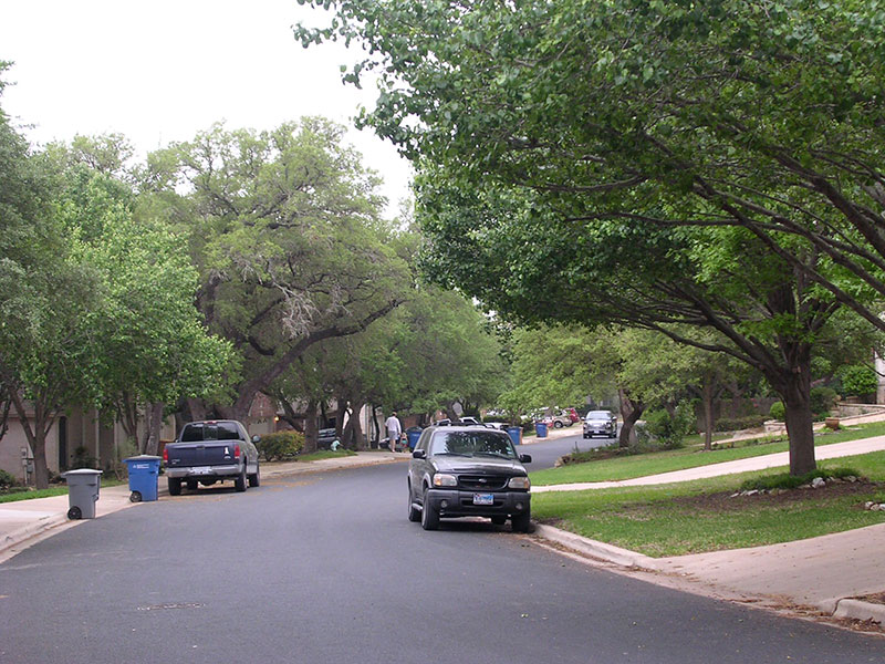 A residential street I often ride. Cars parked on each side can be a problem if there's traffic -- which there often is not.