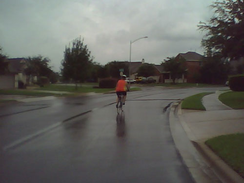 My wife negotiates a curve a few blocks from our house on a rainy day.