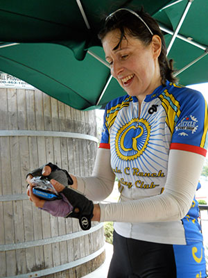 Janice eagerly checks her Strava Suffer Score at the end of a ride.