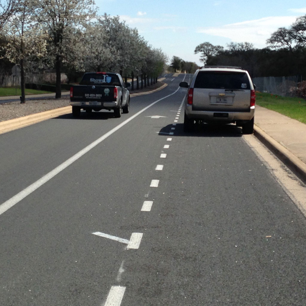 The door zone stripes aren't obvious, but bike riders should be able to spot them easily.